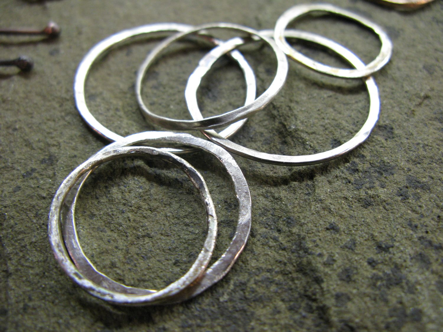 Hand-forged sterling silver rings.