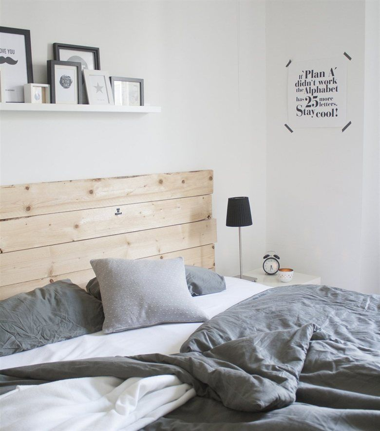 Wooden headboard looks great amongst all the whites and greys ...