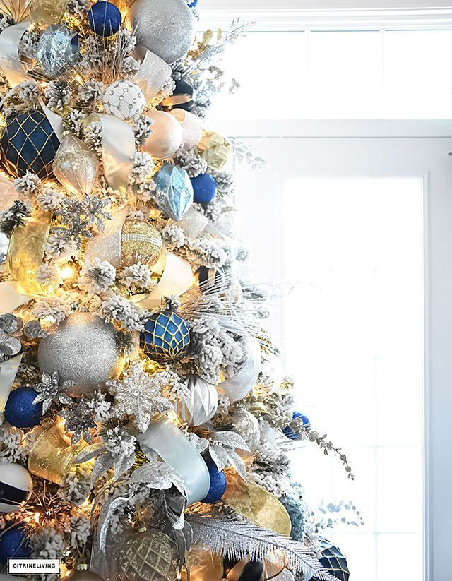 Flocked Christmas Tree With Navy Light Blue Silver And Gold Ornaments Gold Christmas Decorations Silver Christmas Tree Blue Christmas Tree Decorations
