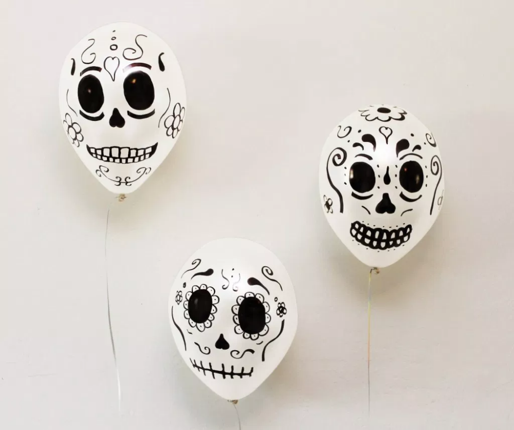 We Got Some White Balloons And Added Some Intricate Skull Designs