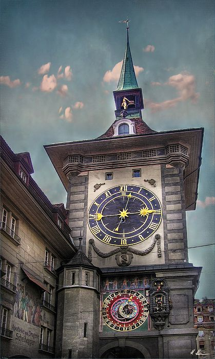 The Clock Bell Tower (Zytglogge Turm) in Switzerlands capital Bern, is one of the town's landmarks and very popular by tourists, especially when the clock movement announces a new hour ! Today's movement and the bells are from 1530 Just four minutes before the hour a rooster crows and a fool seated in a niche is ringing two bells hanging over him, and then a parade of armed bears appears out of the tower and disappears in it again. Then the cock crows for the second time and raises the…