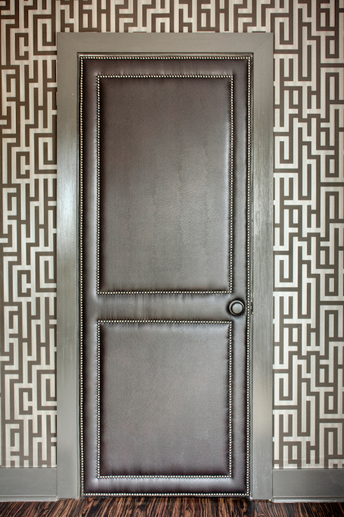entrances/foyers - Graham & Brown Illusion Black and Gold Wallpaper ivory gray fretwork wallpaper black leather door silver nailhead trim Black