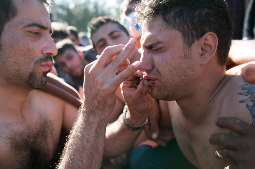 We visited a camp on the Greece-Macedonia border where asylum seekers are being denied entry based on their nationality which the UN says is illegal. Dozens have sewn their lips shut in protest. (Photo by Oscar Webb) by vicenews