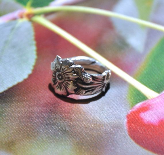 This ring is made with an antique silver plated spoon. Spoon has a wonderful design of three different flowers as seen in pictures above. The ring we