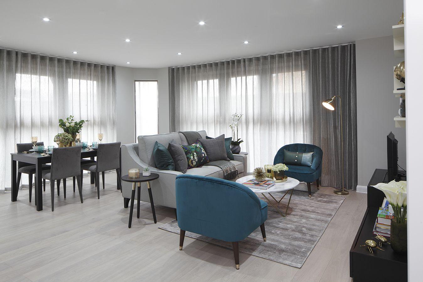 Open Plan Living Grey Oak Floor Sheer Wave Curtains Teal Armchairs Grey Curtains Living Room Gray Oak Floor Living Room Designs #teal #drapes #for #living #room