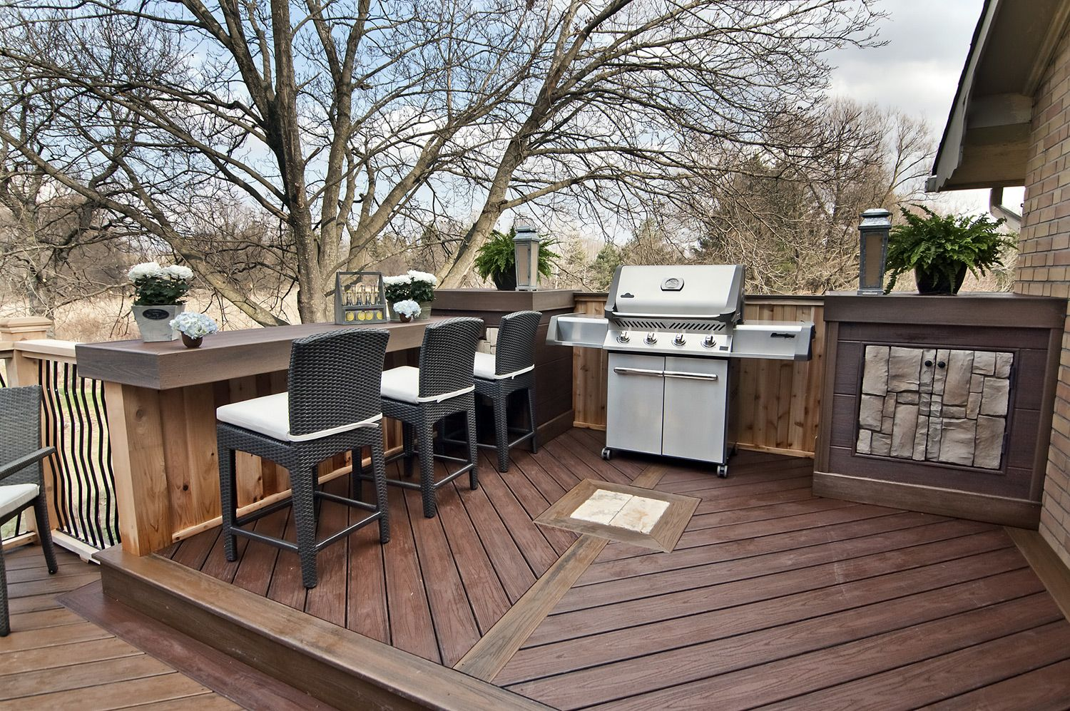 A barbeque nook with side tables a built in cabinet and for Waterfront deck ideas
