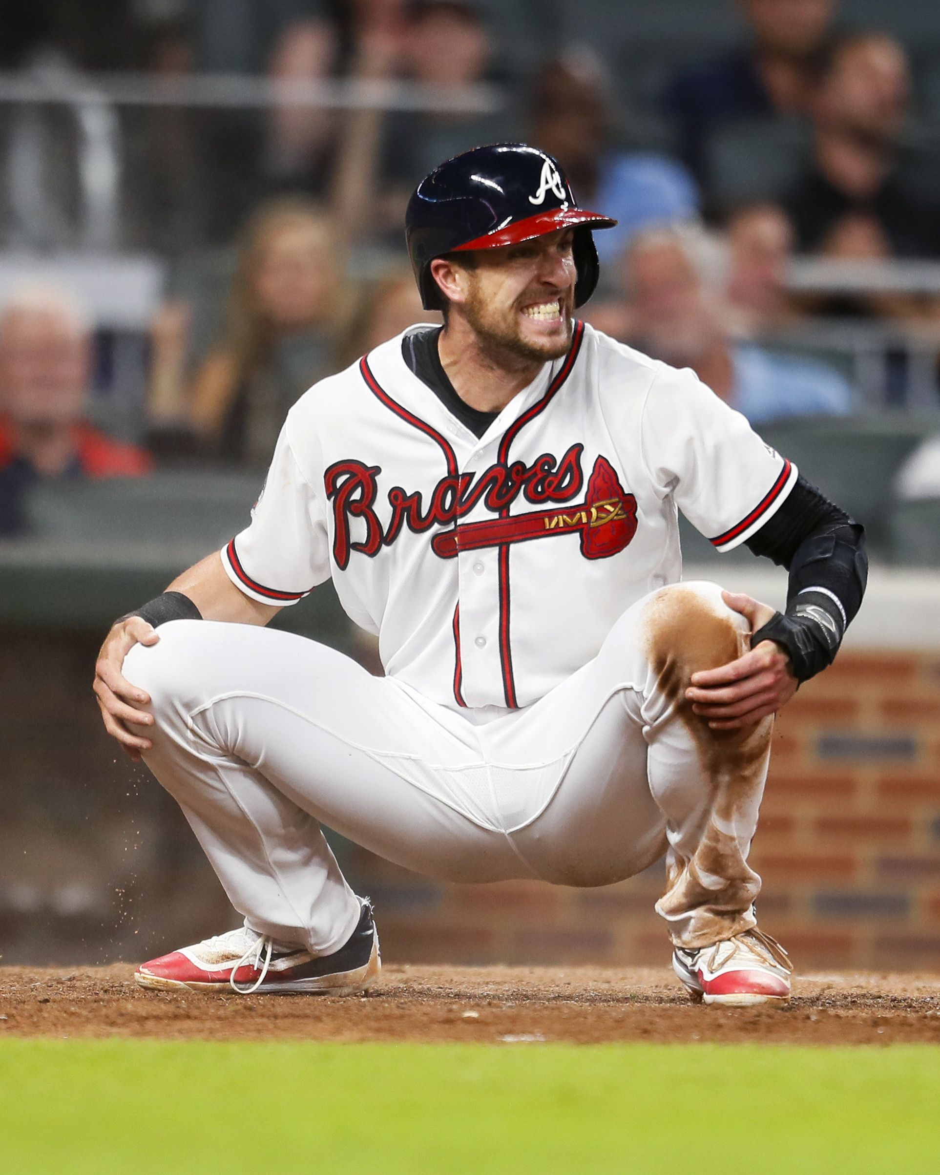 Atlanta Braves Lane Adams reacts after being tagged out at