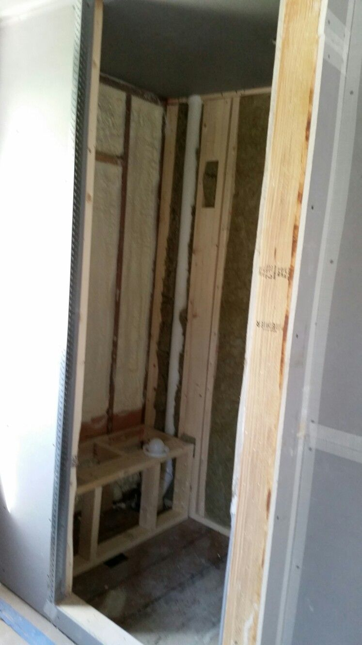 Bathroom shower with bench. Insulation in, waiting on waterproof ...