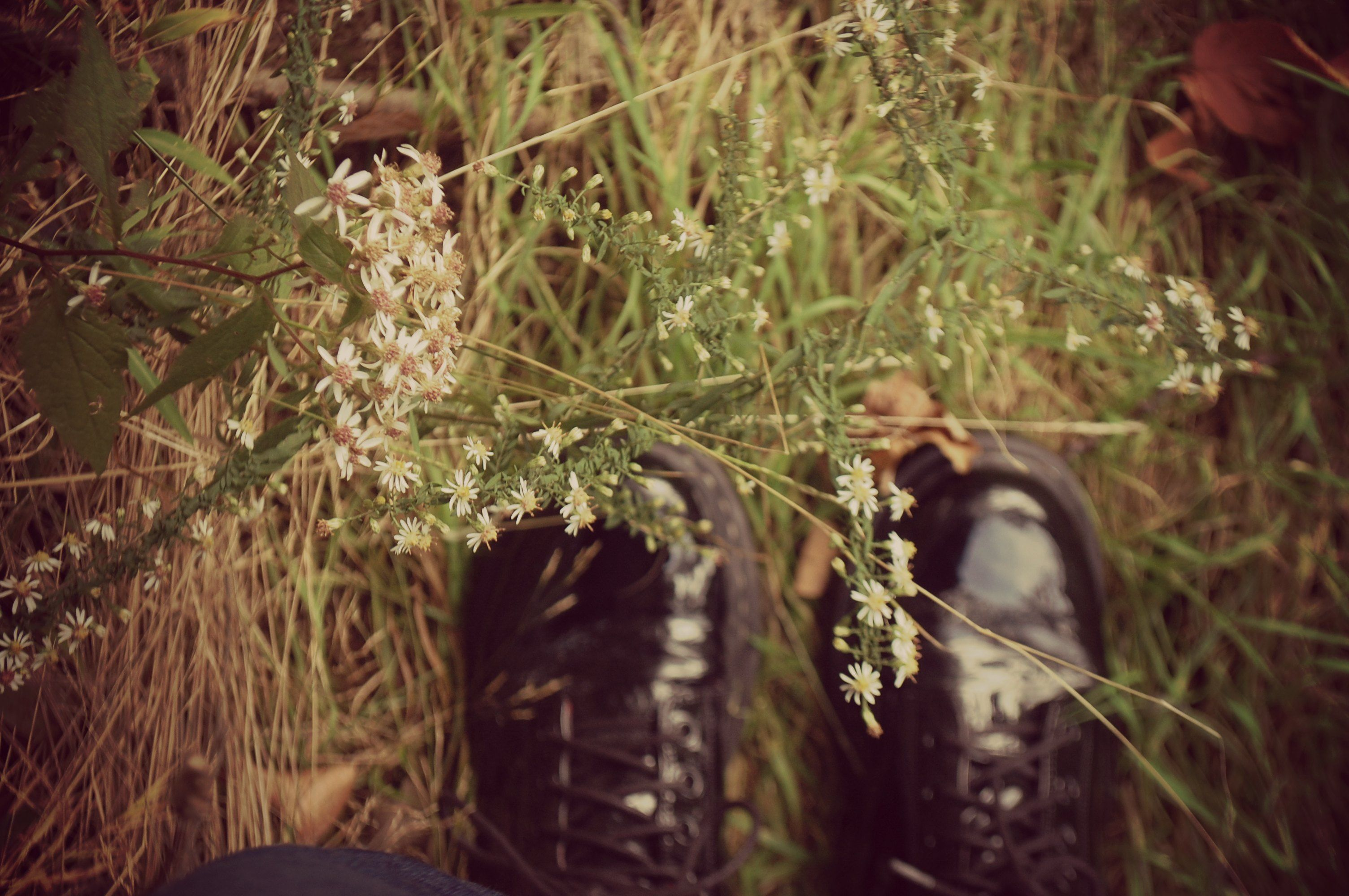 combat boots in the grass