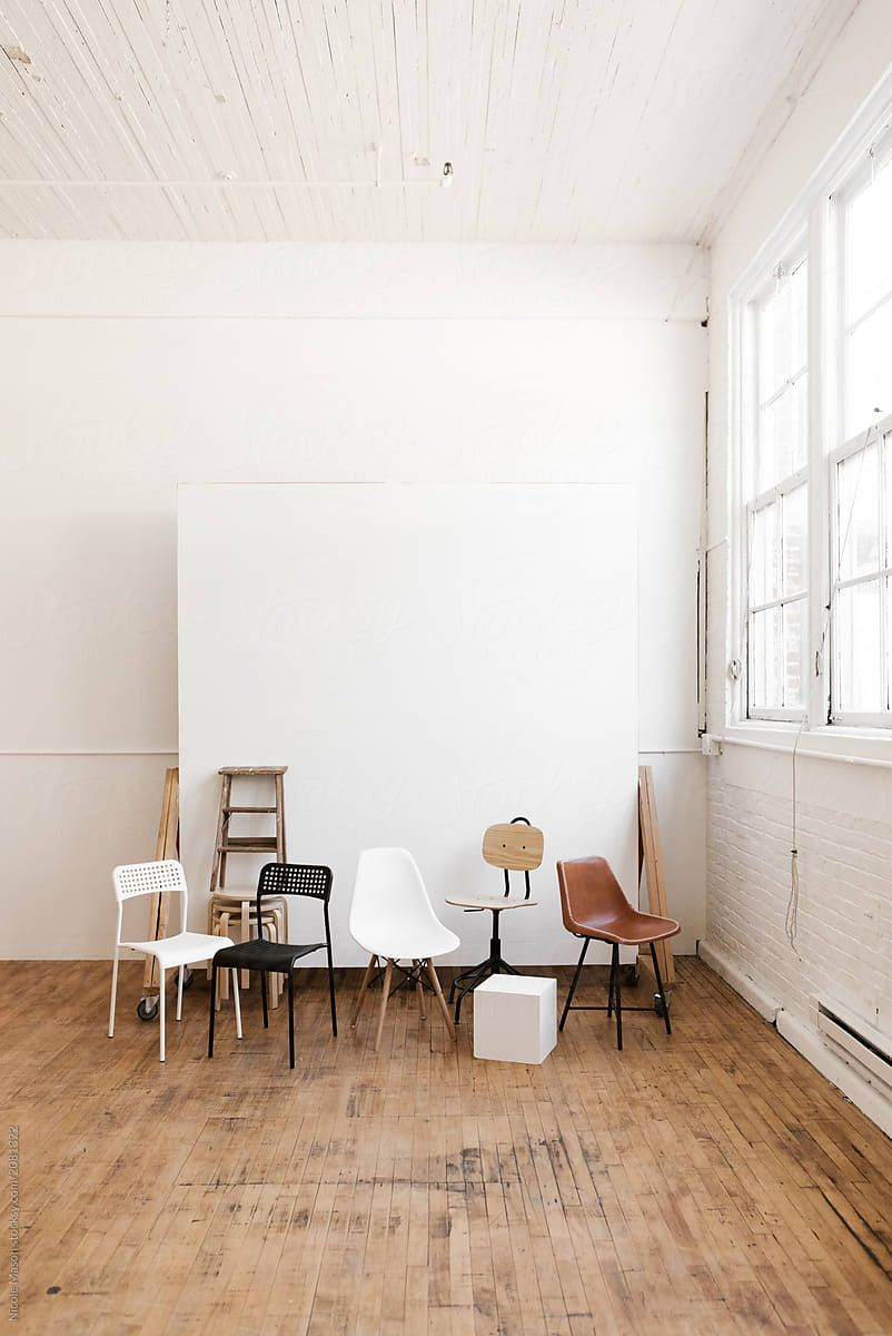 Chairs And Props In Modern White Industrial Photo Studio By Nicole Mason For Stocksy Home Studio Photography Photography Studio Setup Photography Studio Design