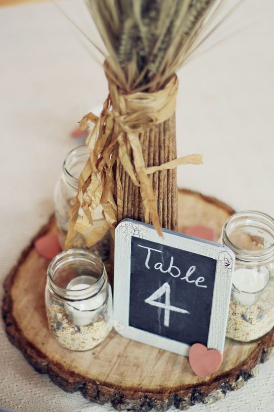 Centerpiece with candles and table number | Salutes and Sunflowers ...
