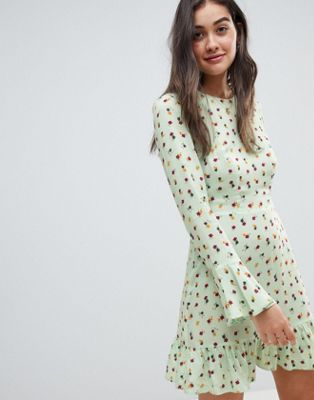 DESIGN fluted long sleeve mini dress with pep hem in ditsy floral i ... f512c91516ace