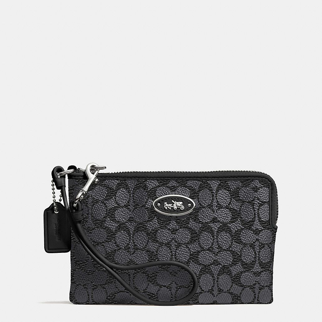 First $10,000 Month - Authentic Coach wristlet.  Style will vary (brown or black)