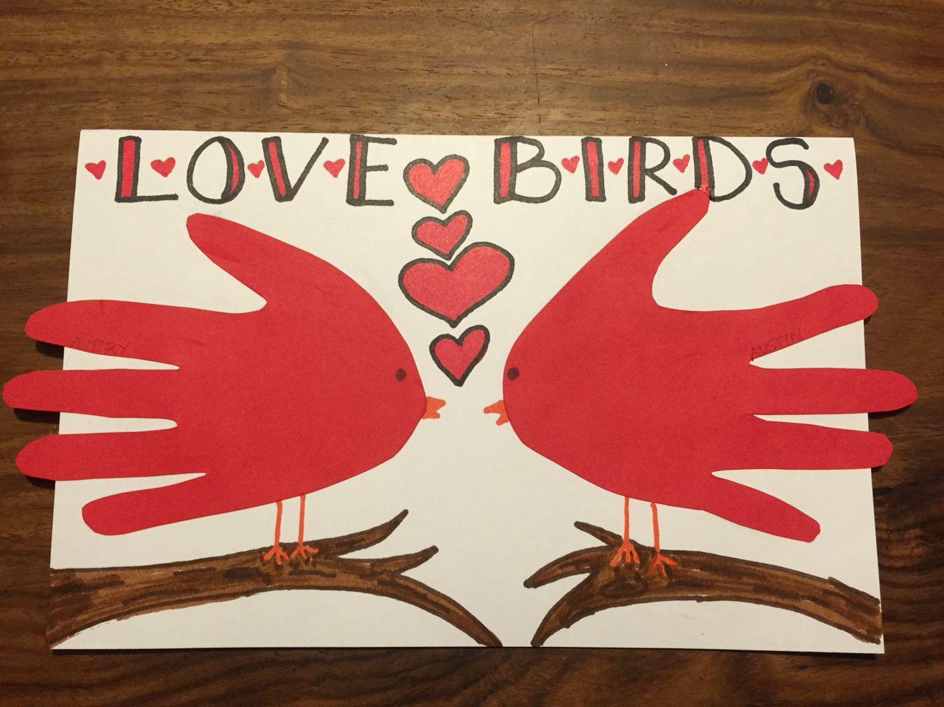 Lovebirds handprint birds. Valentine's Day or anniversary