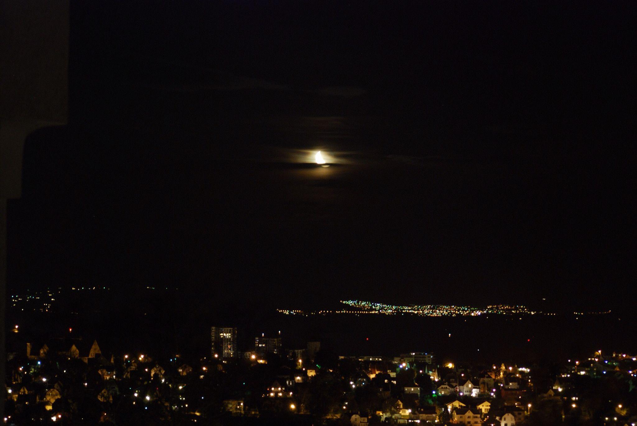 Moon rising above Stavanger.
