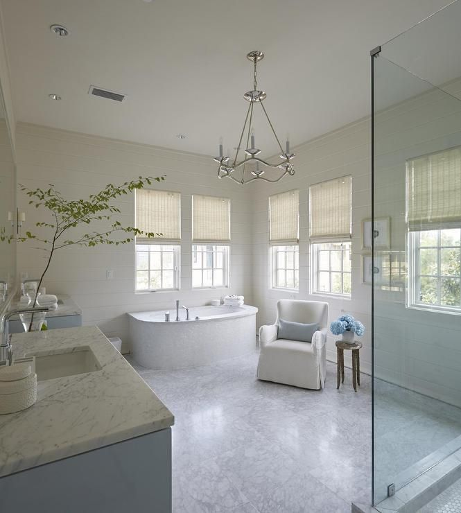 White and blue bathroom with Circa Lighitng Choros Chandelier