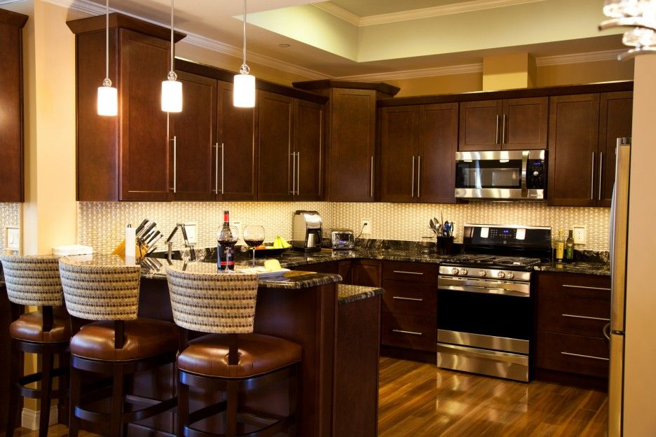 Cute Dark Brown Color Mahogany Wood Kitchen Cabinets Featuring