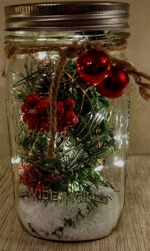This is a Christmas decor piece that is made from a mason jar The