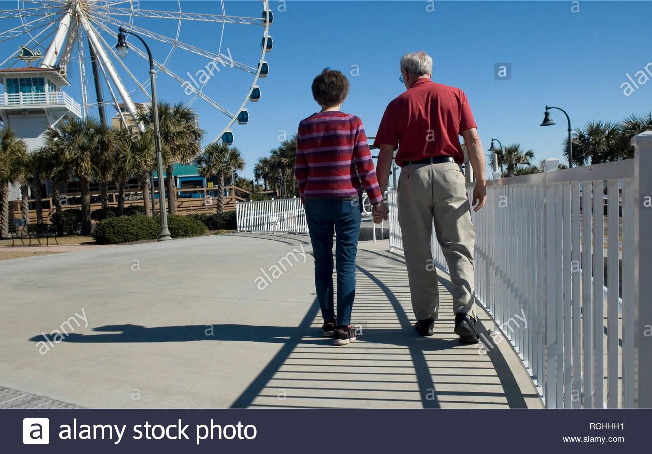Download This Stock Image Senior Couple Walks Hand In Hand At Plyler Park Myrtle Beach South C In 2020 South Carolina Beaches Myrtle Beach South Carolina Myrtle Beach