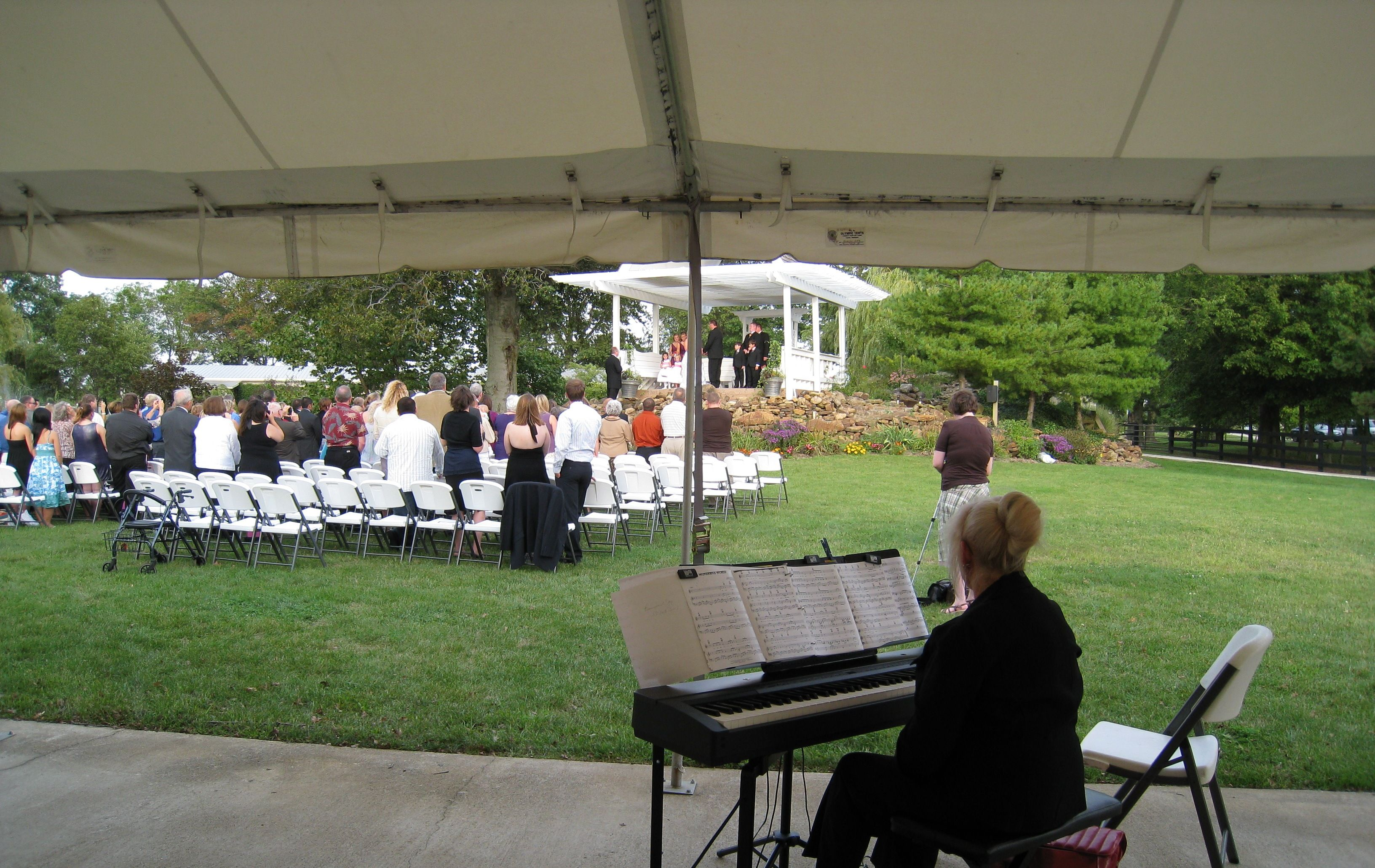 Lumiere du Spa in Lebanon IN is a great outdoor venue for a ceremony. Phyllis providing piano music.