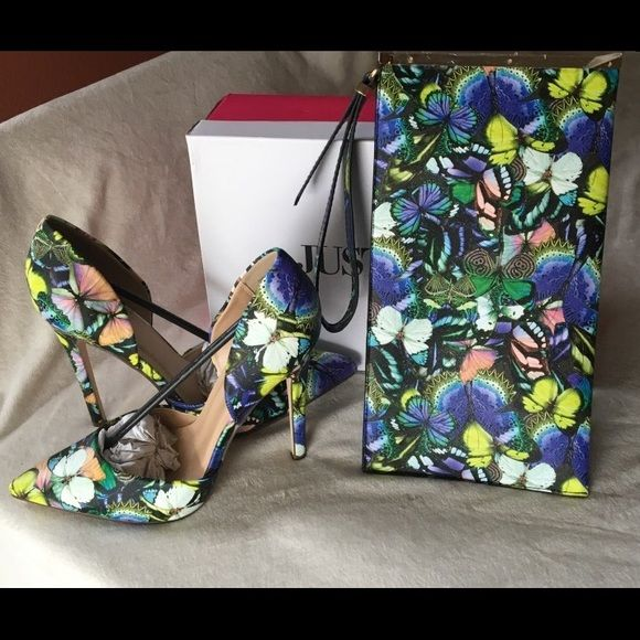Butterfly pattern heels and matching clutch Just fab pointed toe stiletto heels with pretty butterfly pattern and a clutch to match. The clutch also has a zipper closure and a wristlet strap attached to it. Shoes are size 11 and have only been worn once. They are still in the original box with original stuffing. The clutch is NWOT. Has never been used. JustFab Bags Clutches & Wristlets