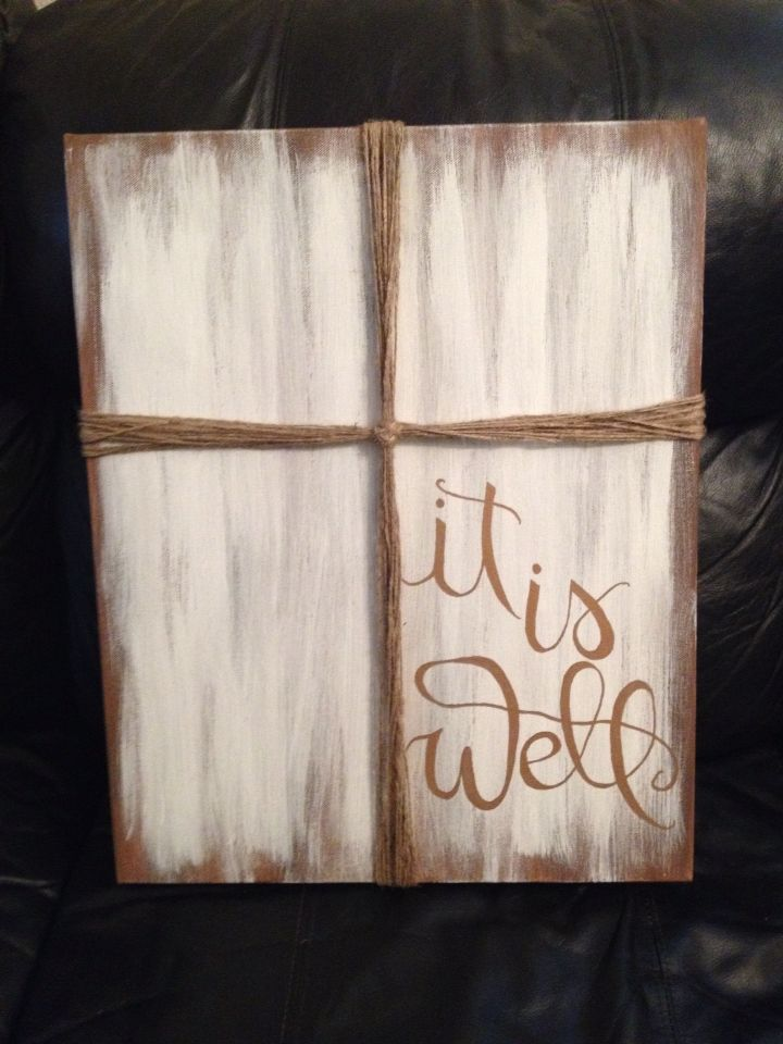 Painted canvas with twine cross Painted canvas