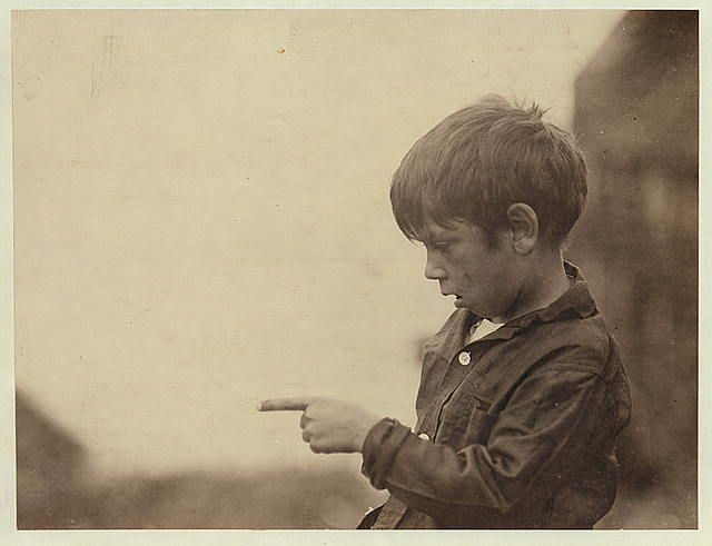 """I cut my finger nearly off, cutting sardines the other day."" Seven year old Byron. (See photo of family, #2453, and label.)  Location: Eastport, Maine. 1911 August."