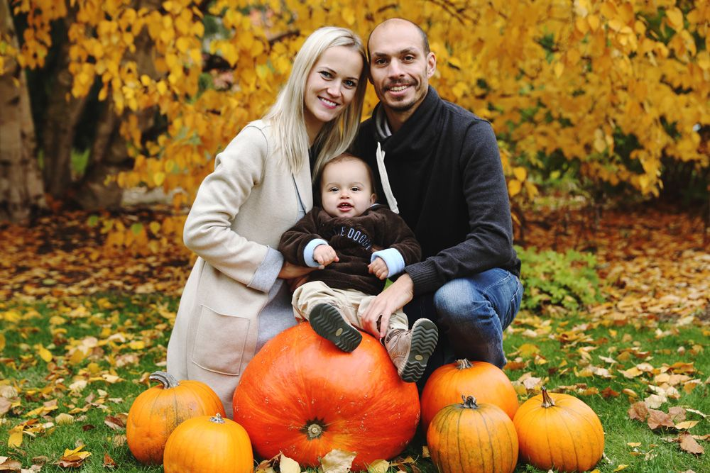 Fall family photo with pumpkins