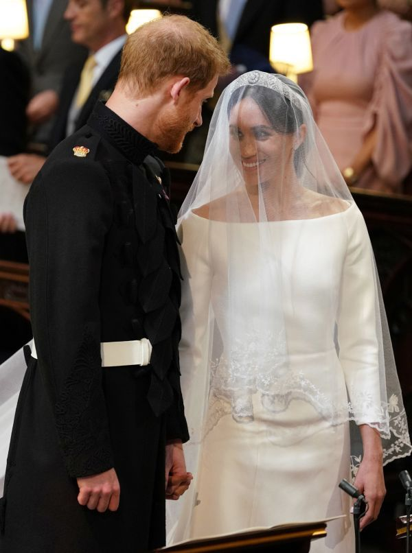 The Duke and duchess of Sussex smile during their ceremony at St