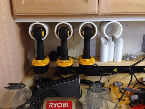 my husband made these drill holders for keeping his workbench clean and organized. PVC Drill ...