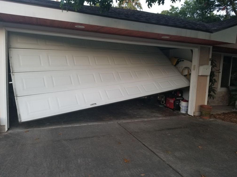 Garage Door Track Repair Houston In 2020 Garage Doors Garage Door Track Doors