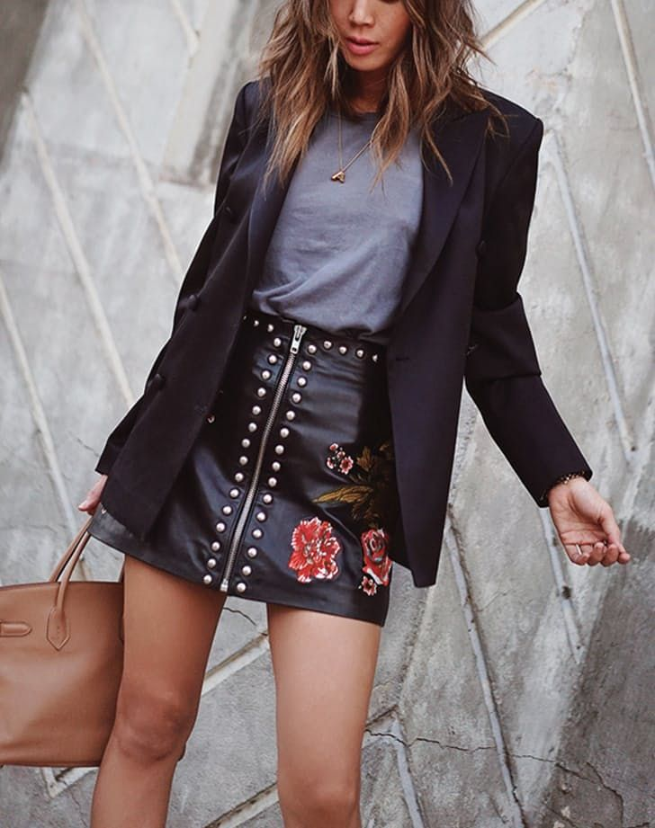 Pair your favorite tee with a leather skirt and a fitted blazer.  I'd choose a sophisticated leather pencil skirt over a mini and pair it with a soft gray or cream tee.  I'd also use a waist length fitted blazer or jacket, just not in leather.  That's way too much leather and borders on the line of cheezy.