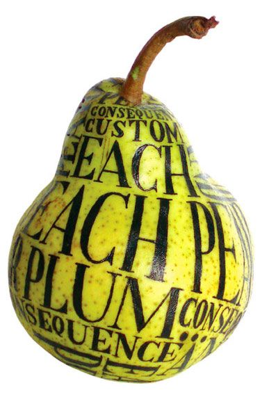 Hand lettering on a pear.