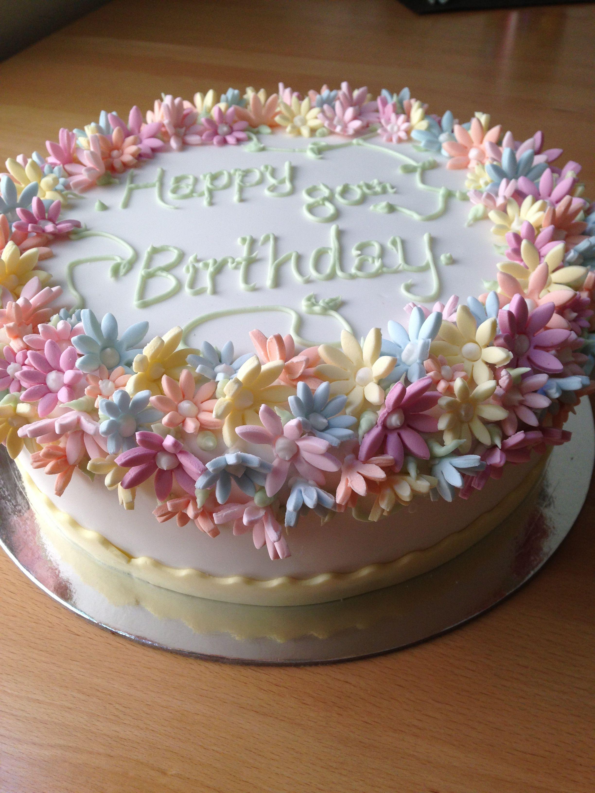 My Nans 80th birthday cake that I made fondant flowers