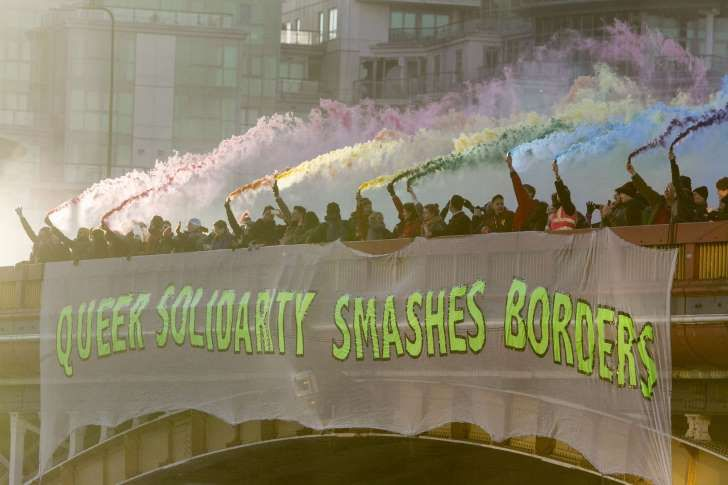 Anti-Trump protest, London, UK - 20 Jan 2017 Protesters unfurl a banner which reads 'Queer Solidarity Smashes Borders' and light smoke flares as part of Bridges not Walls on the day of the Inauguration of Donald Trump as 45th President of the United States to signal their support for tolerance towards others. Photographer:	Amer Ghazzal/REX/Shutterstock