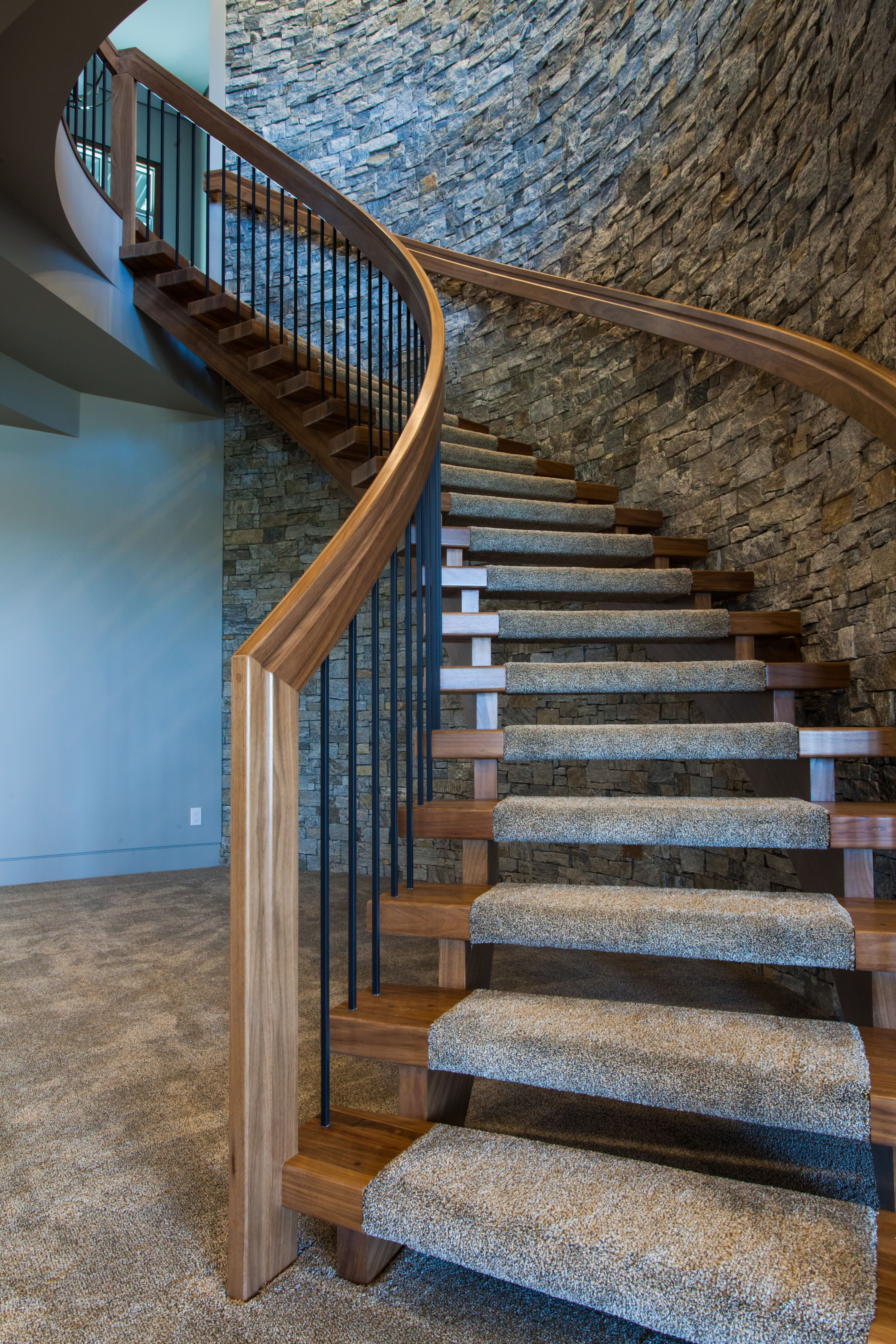 Huge transitional carpeted curved wooden railing staircase ...