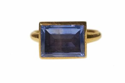 Finger Ring  A gold finger ring with a plain hoop and rectangular bezel set with a foiled Sri-Lankan sapphire. Part of the Cheapside Hoard...