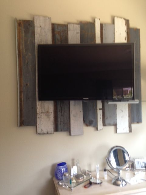 TV with backdrop of old wood fence boards.