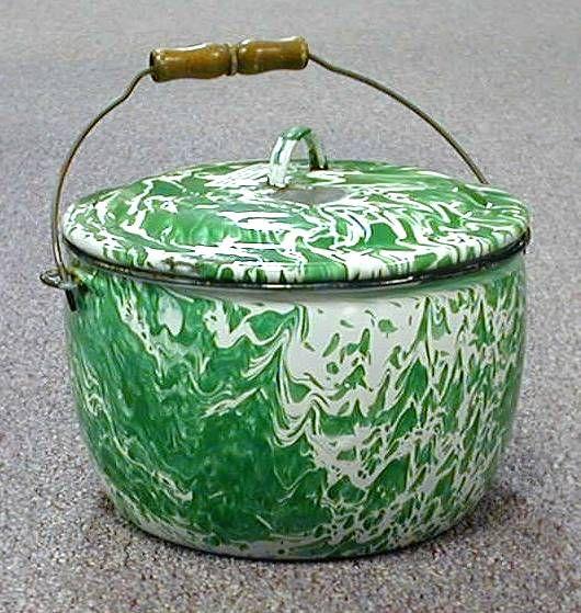 Graniteware and Enamelware. Love the green color.