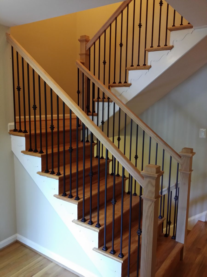 Stair Railings With Black Wrought Iron Balusters And Oak Boxed Type Newel Posts Indoor Stair Railing Stair Railing Design Wrought Iron Stair Railing