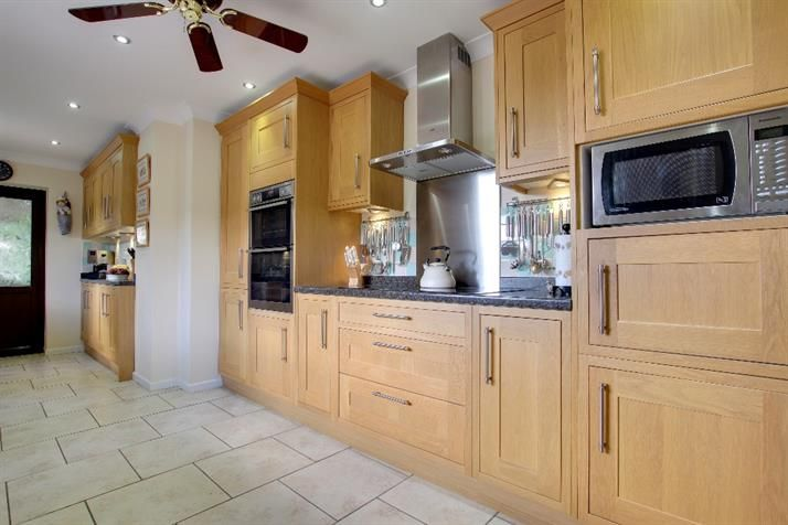 Luxury Kitchen Range Of Solid Wood Floor And Wall Units With Contrasting Work Surfaces