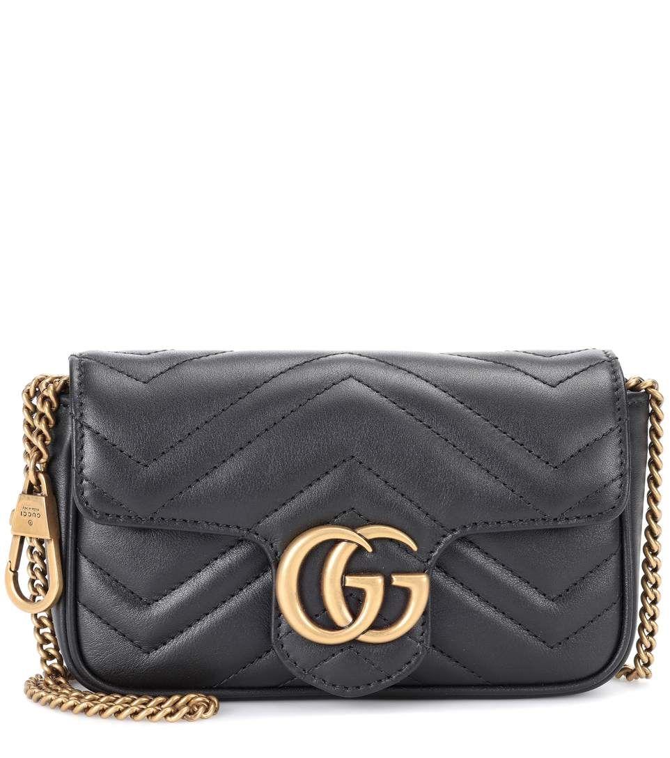 309f54539b Sac cross-body en cuir matelassé noir GG Marmont Mini   Bags   Cuir ...