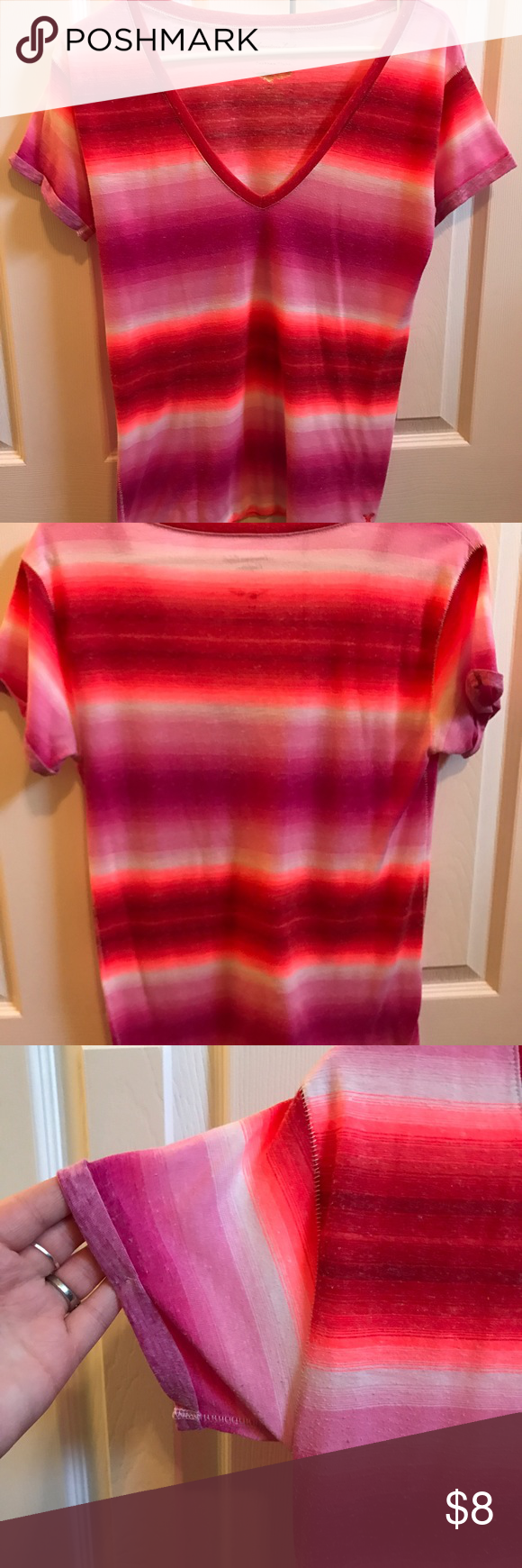 Vibrant AE top This bright American Eagle top is feather light and made to look warn. It is super soft and comfy. The v neck plunges a little down. American Eagle Outfitters Tops Tees - Short Sleeve