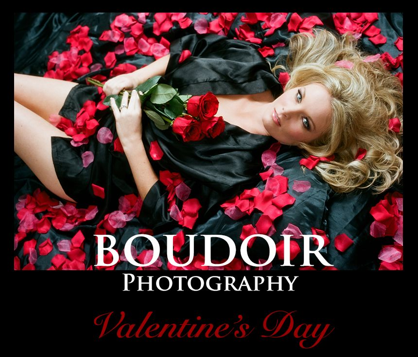 boudoir photo of woman in satin robe posing on black satin sheets with red roses
