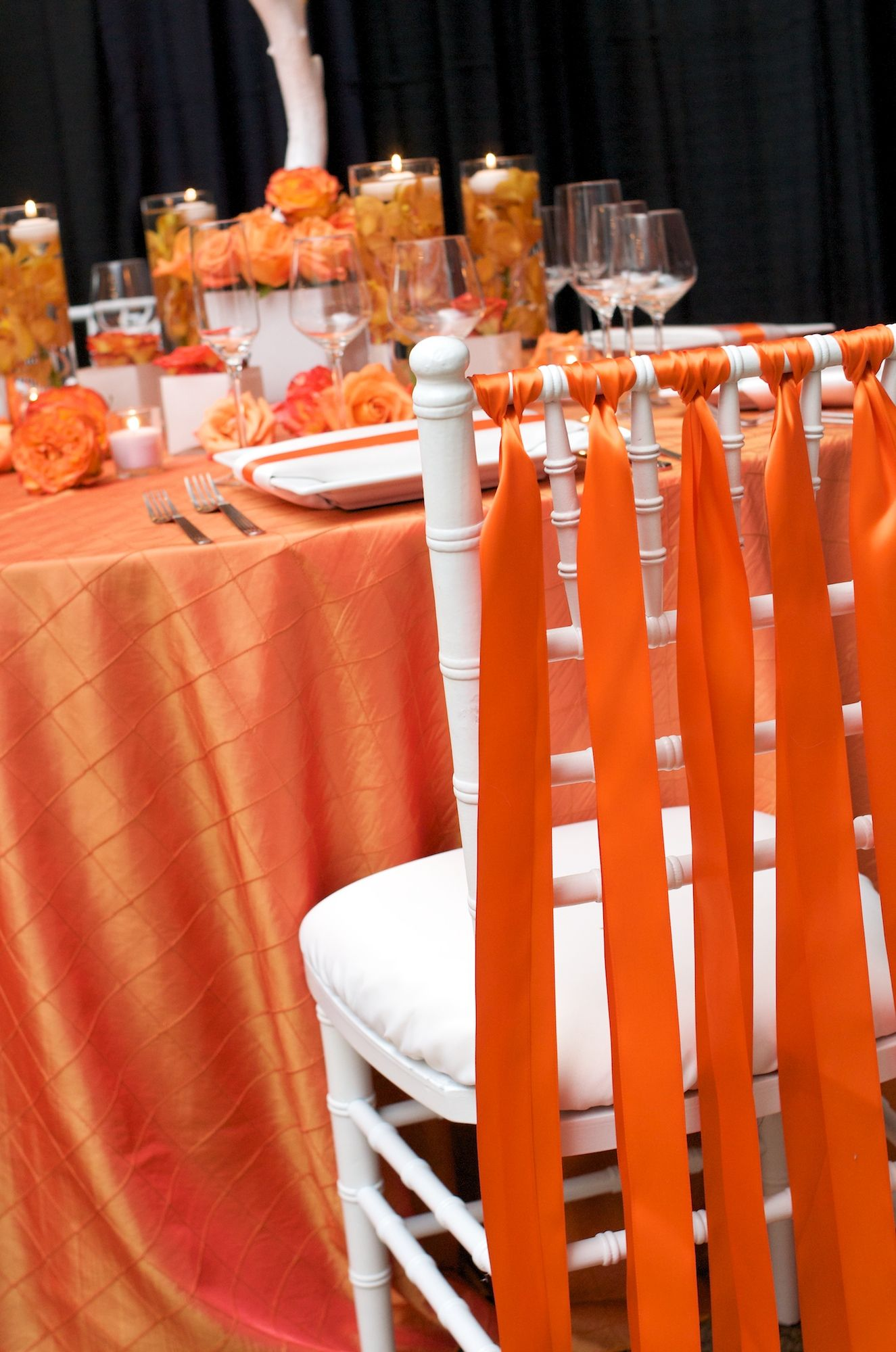 Tangerine colored table setting.  Get your four complimentary tickets to one of our Luxury Bridal Events at www.bridalexpotickets.com