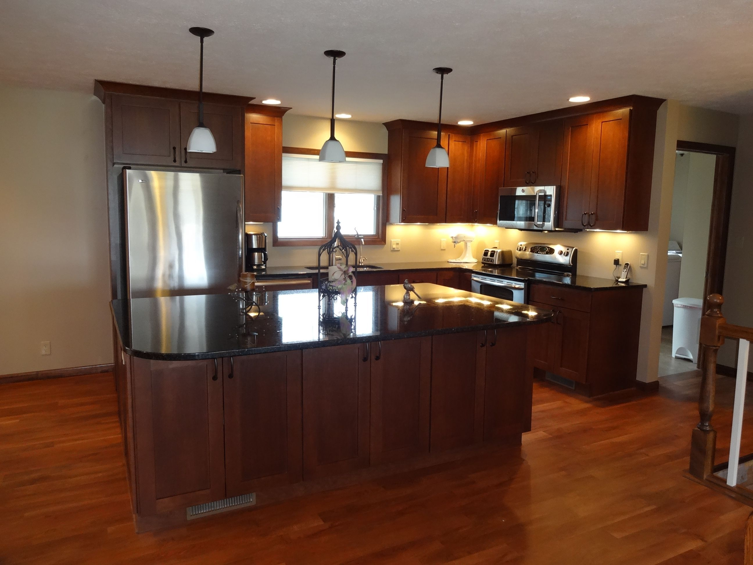 Nice Cherry Cabinets With Cappuccino Stain With Uba Tuba Granite