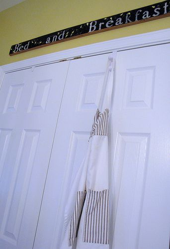 I have a ton of aprons, and they really need to come out of the drawer and onto some hooks. Hanging them from the pantry door is a neat idea! (This calls for a trip to IKEA...)