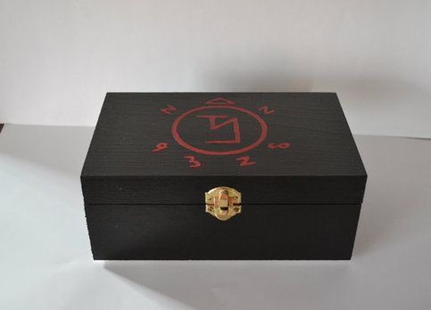Hand-painted wooden keepsake box inspired by Supernatural. An angel banishing sigil is painted in red on a black lid. Box is painted all black exterior and interior. The box measures 8 1/2 inches long by 5 1/4 inches wide and 3 1/2 inches in height.  Inside is finished painted black with black ...