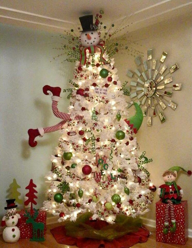 White Christmas Tree with Green & Red balls & looks like elf going ...
