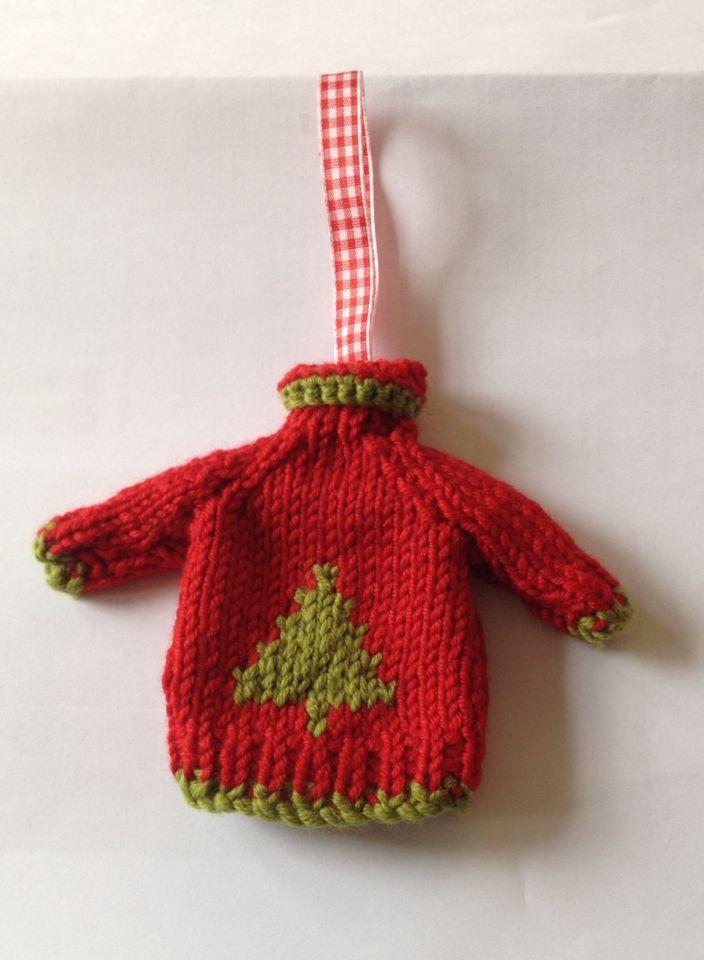 Simple Raglan sleeved mini jumper featuring a Christmas tree.